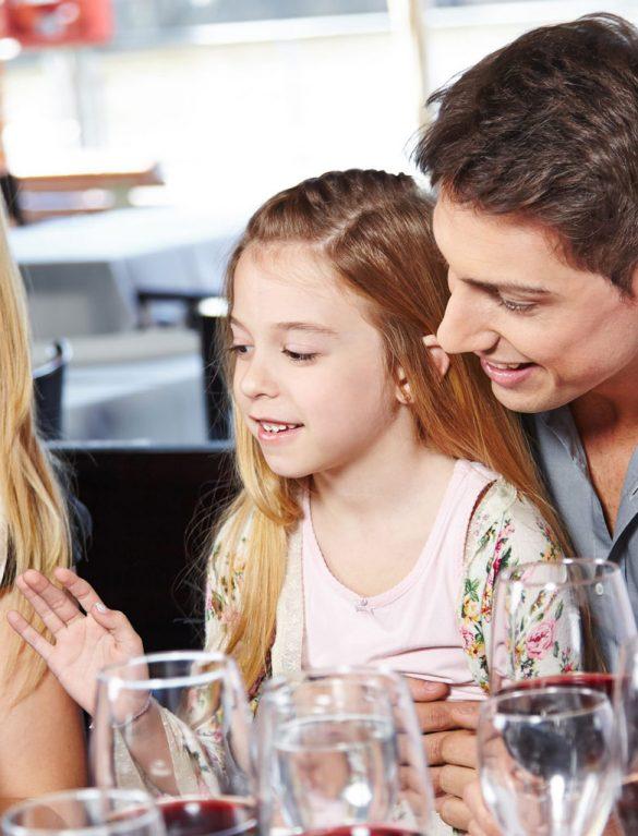 Happy family celebrating in hotel bar