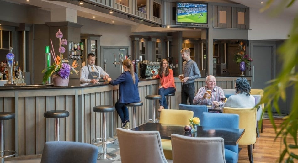 Hotel guests enjoying a drink at the bar in Maldron Hotel Wexford